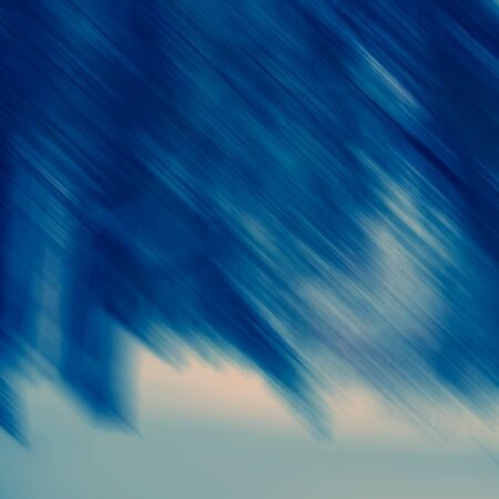 Abstract diagonal spots and lines in blue tonality, blurred background