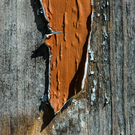 Old paint on a wooden surface.
