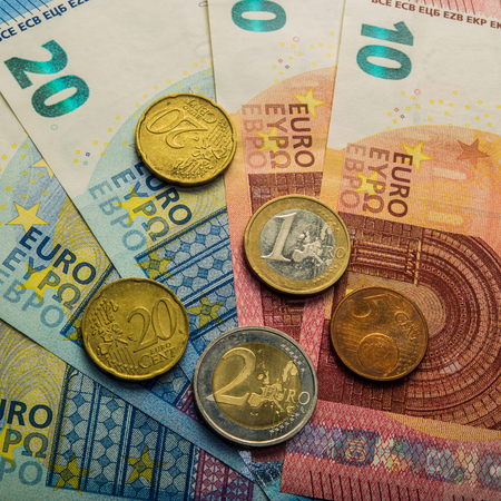 paper euro banknotes and coins. Coins one, two euros. Coins twenty and five euro cents. Currency of the European Union.