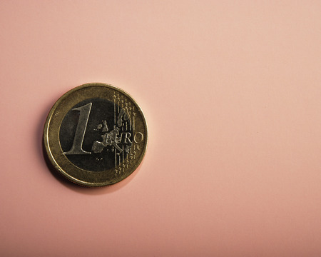 coin one euro on a pink background. Business metaphor. Conceptual. Stock Photo