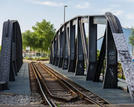 old metal bridge for railway transport and pedestrians in Basel, Switzerland. Europe. Stock Photo