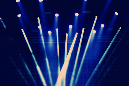 concert lighting of a free scene. Stage lights on a dark background. Stock Photo