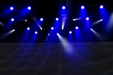 concert lighting of a free scene. Stage lights on a dark background. 스톡 콘텐츠