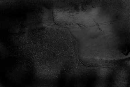 Black gray water surface background in grunge style. Abstract dashed, scratched, vintage effect with noise and grain Dark background for design and video editing. Blurred. Reklamní fotografie - 101558551