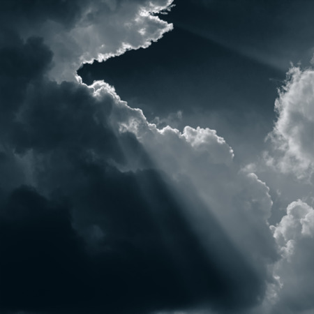 Blurred background. Dark clouds and sunrays. A square web banner. Stok Fotoğraf