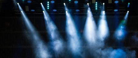 Lighting the stage during a musical rock concert and artificial fog. Web banner.