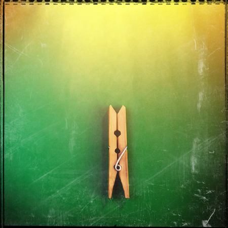 wooden clothespin on a green background. Element of design. Web banner. Stock Photo