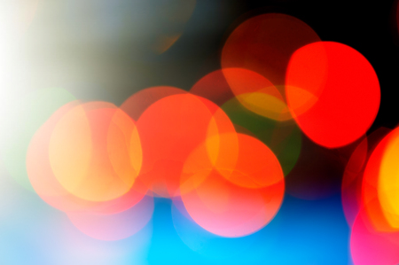 Abstract defocused festive background, red color spots. Blurred color background. For design.