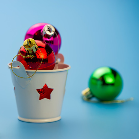 Christmas balls in a candlestick on a blue background.  New year concept.
