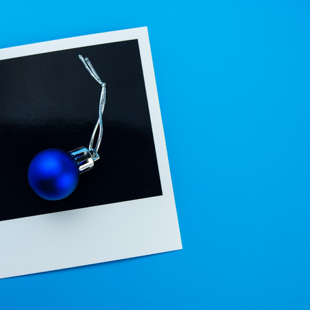 Christmas toys balls and polaroid print. Christmas composition, winter season. For your design.