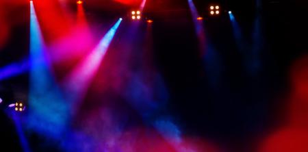 floodlights scene during a rock concert. Blurred background. Web banner. Element of design.