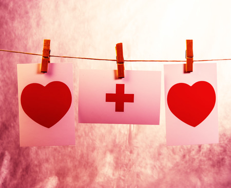 two hearts are hanging on a rope pinned clothespins.  For postcard design. Archivio Fotografico