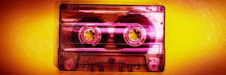 old audio cassette is on a yellow background. Web banner.
