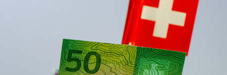 Fifty Swiss francs bill on flag background. Business concept. Web banner. Фото со стока