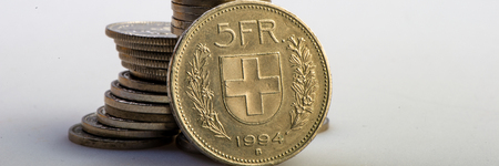 Swiss franc coin lying on a stack of coins. Business concept. Web banner. Editorial