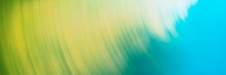 Abstract blurred light background, yellow, blue circular lines. Web banner for your design.