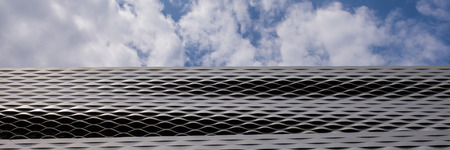 BASEL, SWITZERLAND - JUNE 12 2017: Exhibition Center in Basel Switzerland. Fragment of the sky and the metal surface. Web banner for your design.
