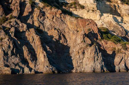 Landscape Sea Rocky Coast at Sunset. Sea and Rocks. Summer season. Ukraine.