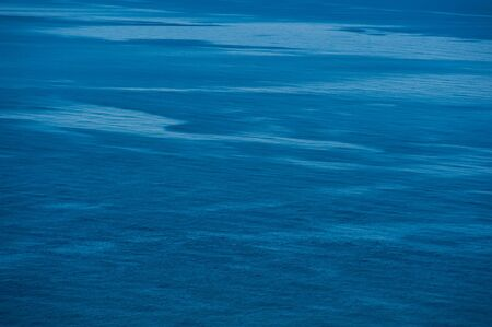 surface of the water in the sea on a sunny day. Summer season, august.