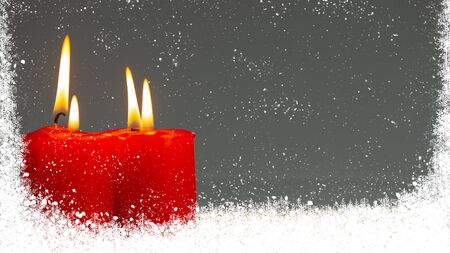 Burning candles of red color in a window covered with snow. Christmas holiday background.