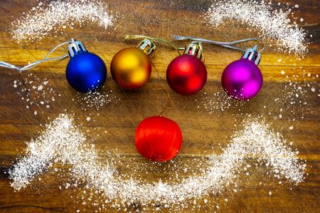 Christmas Festive Background. Four Multi-Colored Balls Lie on an Oak Board and Snow. Web Banner.