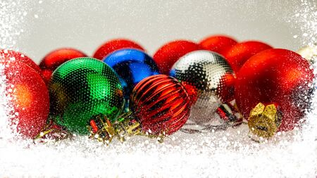 Christmas Festive Background. Multi-colored Christmas toys balls and snow. Web banner.