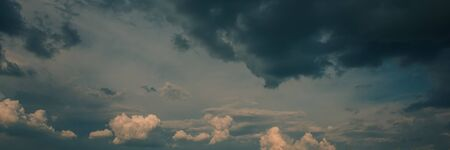 Dark and White Rain Clouds at Sunset. Panoramic Countryside Landscape. Spring Season, May. Web Banner. Natural Background. 写真素材