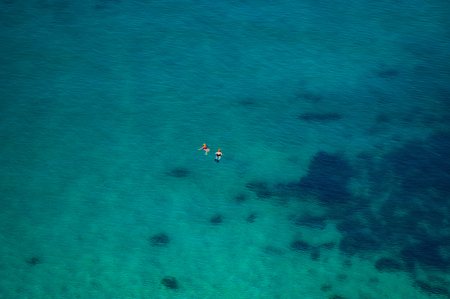 CRIMEA, UKRAINE- August 2010: couple of people swimming in the sea on a sunny day in shallow water. Summer season, august. Black Sea. Editorial
