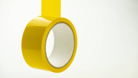 Single yellow colored adhesive tape on a light background. For design. Web banner.