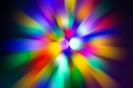 Abstract blurred color background - radial colored rays of purple, pink, green, yellow, red, black, White. For design. Banco de Imagens