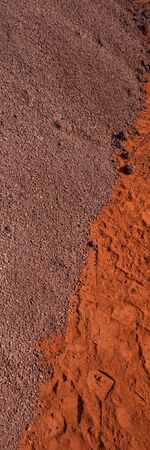 crushed iron ore in an industrial warehouse. Vertical Web Banner. 版權商用圖片