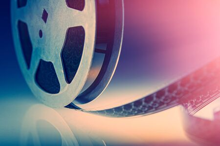 reel of untwisted vintage film lies on a table. Cover. Web banner. Element for design.