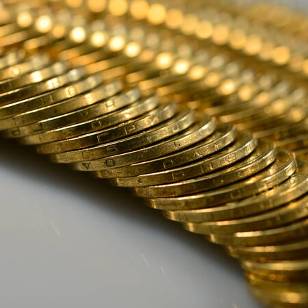 rows of golden coins lie on the table. Financial background. Web banner.