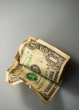 Crumpled paper money note one US dollar. Business concept.