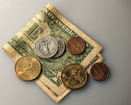 One US dollar cash note and coins. Business concept.