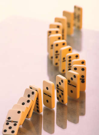 Domino stands in a curved line on a light background. Business concept.