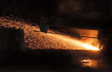 Metallurgical equipment and technology of iron production. Molten hot steel. Archivio Fotografico