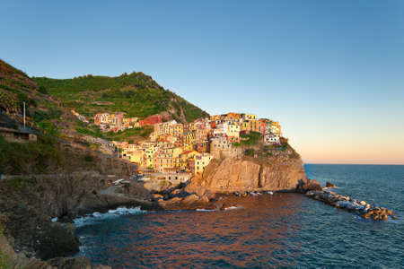 Small Town Manarola (Cinque Terre, Italy) during sunset photo