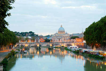 angelo: Evening view at the Angelo bridge and St. Peters Basilica in Rome, Italy Stock Photo