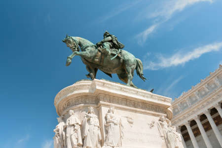 Statue near the Monument of the Vittorio Emanuele II in Rome, Italy photo