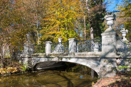 nymphenburg palace: Bridge in the autumn park Stock Photo