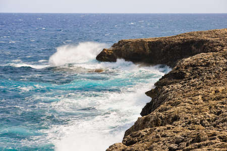 Stormy sea waves break on big rock Stock Photo - 10374186