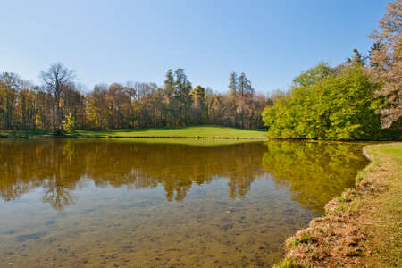 nymphenburg palace: Beautiful pond in the autumn park Stock Photo