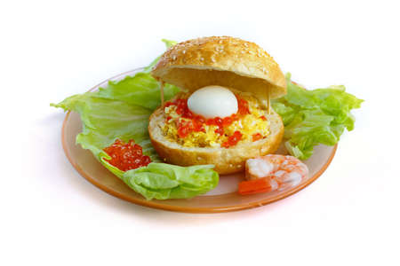 Sandwich with egg and caviar isolated on white photo