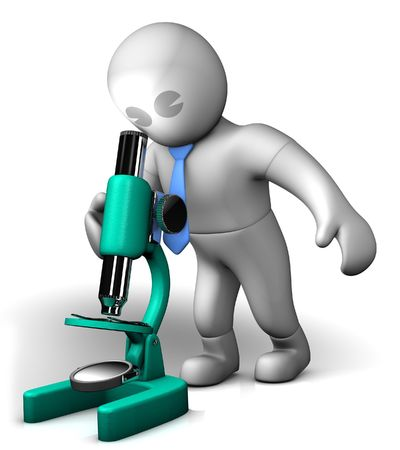 A man looking into a microscope Stock Photo