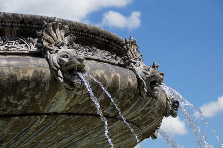 gargoyles: An ornate fountain in front of the New Palace in Stuttgart in detail the Lwenkpfe on the big shells splash out the water in the bow Stock Photo
