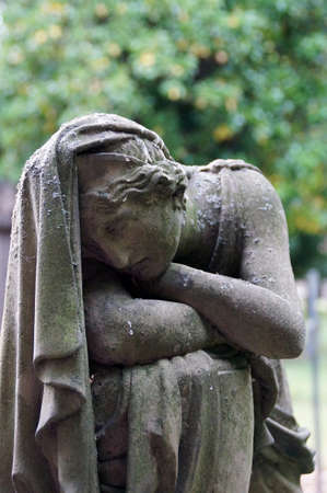 An old and weathered by the centuries statue is an impressive mourning  Melancholy, apathy, helplessness, all this shows the finely crafted sandstone statue of a beautiful woman  The statue is dressed in the style of a Greek and stands on Stuttgart s olde