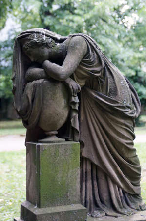 apathy: An old and weathered by the centuries statue is an impressive mourning  Melancholy, apathy, helplessness, all this shows the finely crafted sandstone statue of a beautiful woman  The statue is dressed in the style of a Greek and stands on Stuttgart s olde