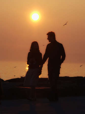 Hand in hand. To take eachh other by the hand. To join forces togetherness love silhouette photo