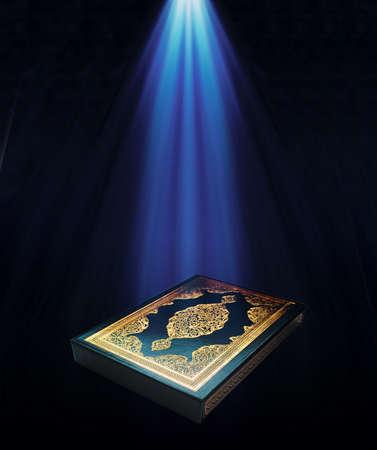 A KUR'AN-I KERIúM under a light.